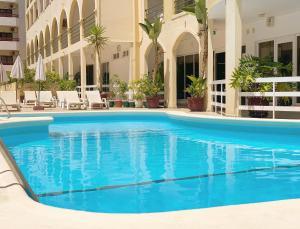Het zwembad bij of vlak bij Aparthotel Calema Avenida Jardim