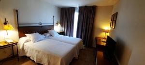Cama o camas de una habitación en Sant Jordi