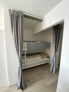 A bunk bed or bunk beds in a room at Apartment Bel-Air