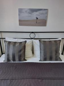A bed or beds in a room at Apartments Coral of Dubrovnik