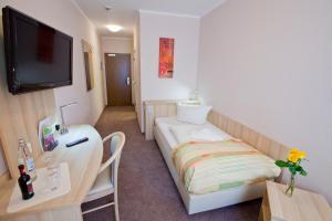 Ein Bett oder Betten in einem Zimmer der Unterkunft Hotel Siebenschläfer