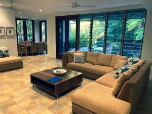 A seating area at Sanctuary Palm Cove