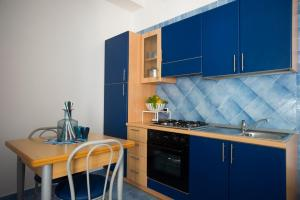 A kitchen or kitchenette at Residence Hotel Panoramic