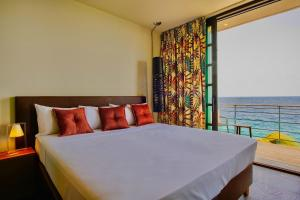 Een bed of bedden in een kamer bij Pietermaai Boutique Hotel
