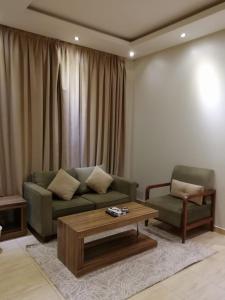 Uma área de estar em بيت الدومه النرجس 2