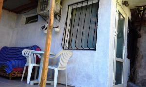 Балкон или терраса в Дом на пляже