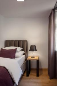 A bed or beds in a room at MOODs Charles Bridge