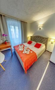 Łóżko lub łóżka w pokoju w obiekcie Great Polonia Jelenia Góra City Center
