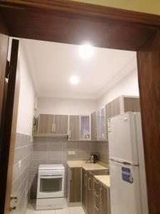 A cozinha ou cozinha compacta de (شقق الورود (الفخامة والتميز