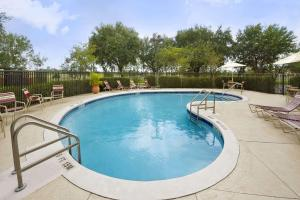 The swimming pool at or near Ramada by Wyndham Suites Orlando Airport