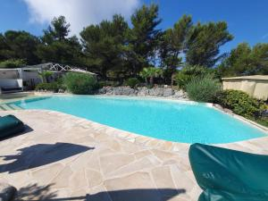 The swimming pool at or near Eze Hermitage Hôtel