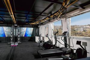 The fitness center and/or fitness facilities at Palladium Hotel