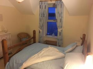 A bed or beds in a room at Monzie Villa