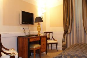 A television and/or entertainment center at Boutique Hotel Trevi