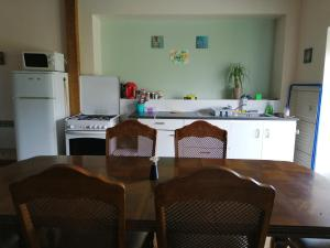 A kitchen or kitchenette at Les Ourieres