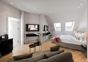 Télévision ou salle de divertissement dans l'établissement Crowne Plaza Berlin - Potsdamer Platz, an IHG Hotel