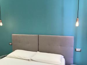 A bed or beds in a room at La Siesta