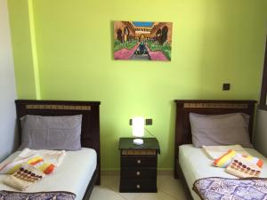 A bed or beds in a room at Tanja Lucia Hostel