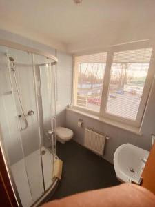Koupelna v ubytování Penzion Na Kurtech