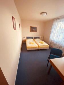 Postel nebo postele na pokoji v ubytování Penzion Na Kurtech