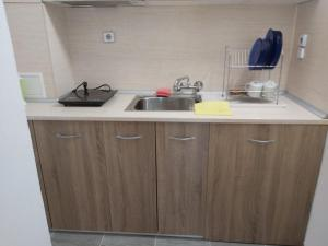 Кухня или кухненски бокс в Къща за гости Атанасови