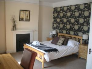 A bed or beds in a room at The Cornerhouse
