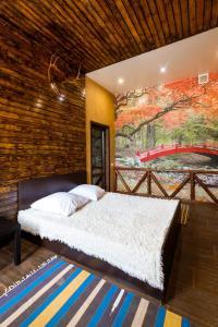 Кровать или кровати в номере Hotel Shokolad