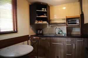 A kitchen or kitchenette at Pondok Agung Bed & Breakfast