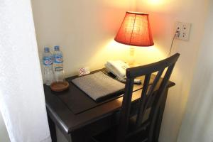 A bed or beds in a room at Hotel Khamvongsa