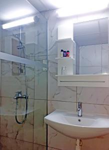 A bathroom at Marina Hotel