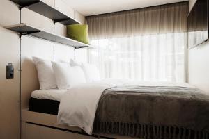 Voodi või voodid majutusasutuse Hektor Container Hotel toas