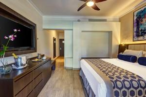 A television and/or entertainment centre at Royalton Splash Punta Cana Resort & Spa - All Inclusive