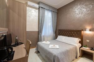 Cama ou camas em um quarto em Hotel Centro Cavour Roma