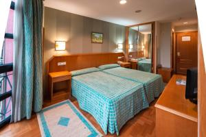 A bed or beds in a room at Astures