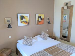 Un ou plusieurs lits dans un hébergement de l'établissement Hôtel Licetto