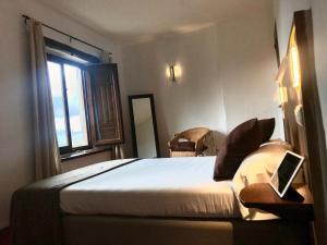 Cama o camas de una habitación en La Oveja Verde de la Alpujarra