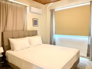 A bed or beds in a room at Himonas Apartments