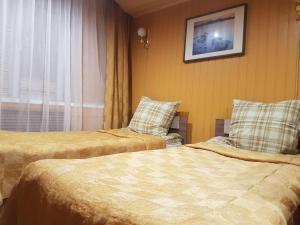 """Кровать или кровати в номере Трактир """"Нижегородский"""""""