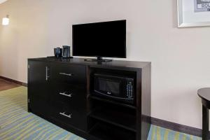 A television and/or entertainment center at La Quinta by Wyndham Durant