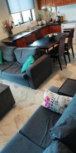 A seating area at Panorama house leika kalamatas