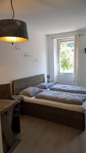 A bed or beds in a room at B&B Die Quelle
