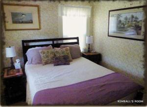 A bed or beds in a room at Spruce Moose Lodge