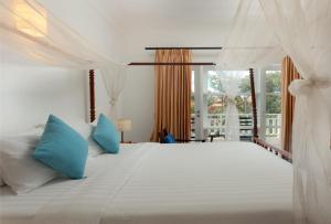 Cama o camas de una habitación en Amber Angkor Villa Hotel & Spa