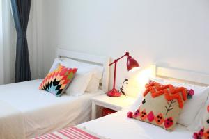 Cama o camas de una habitación en Peking Youth Hostel