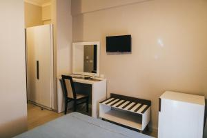 A television and/or entertainment centre at Fanari Hotel