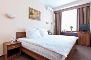 Кровать или кровати в номере Гостиница Дубки