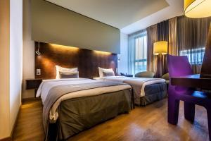 Een bed of bedden in een kamer bij Dutch Design Hotel Artemis