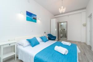 A bed or beds in a room at Villa Lux