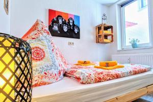 Ein Bett oder Betten in einem Zimmer der Unterkunft Uhlpartment - Historisches Apartment im Herzen von Uelzen