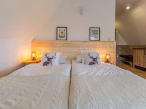 Łóżko lub łóżka w pokoju w obiekcie Willa Natura